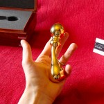 Cocoa London Small Curved Gold Dildo in the hand